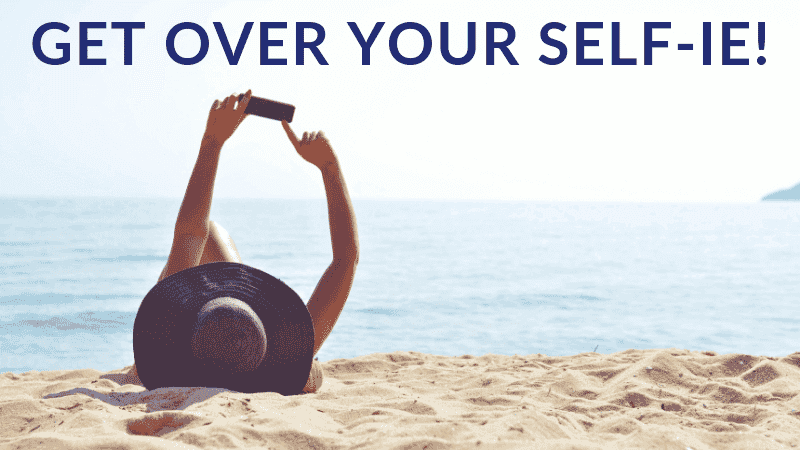 female on beach taking a selfie